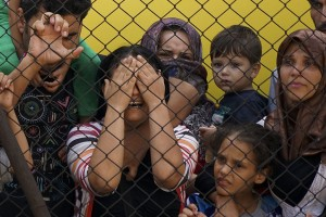 Women_and_children_among_Syrian_refugees_striking_at_the_platform_of_Budapest_Keleti_railway_station._Refugee_crisis._Budapest_Hungary_Central_Europe_4_September_2015._3-300x200.jpg